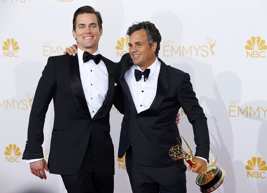 "Matt Bomer and Mark Ruffalo pose with their Outstanding Television Movie award for HBO's ""The Normal Heart"" at the 66th Primetime Emmy Awards in Los Angeles"