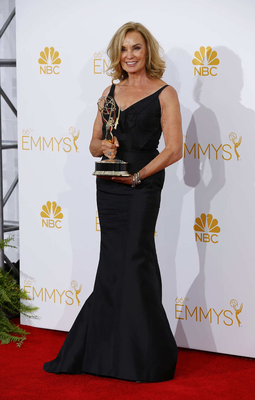 Jessica Lange poses with her award at the 66th Primetime Emmy Awards in Los Angeles