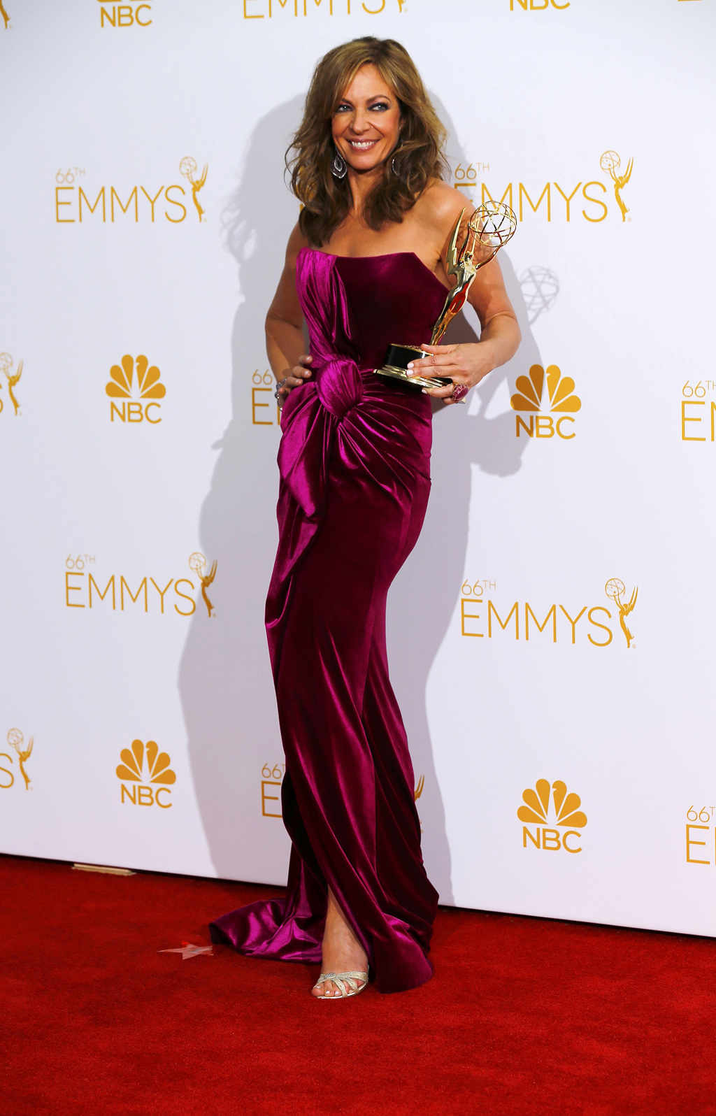 Allison Janney poses with her Outstanding Supporting Actress in a Comedy Series award at the 66th Primetime Emmy Awards in Los Angeles