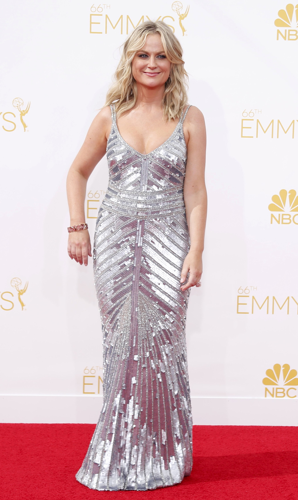 "Actress Amy Poehler from the NBC sitcom ""Parks and Recreation"" arrives at the 66th Primetime Emmy Awards in Los Angeles"