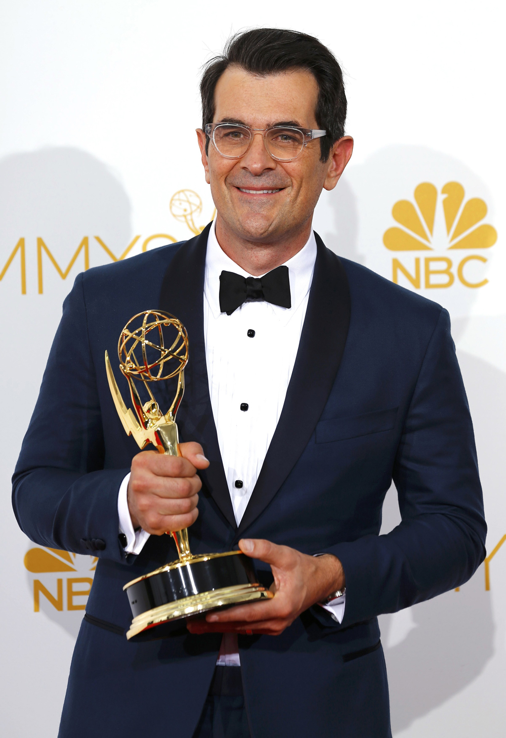 "Ty Burrell poses with his Outstanding Supporting Actor in a Comedy Series award for the ABC sitcom ""Modern Family"" at the 66th Primetime Emmy Awards in Los Angeles"